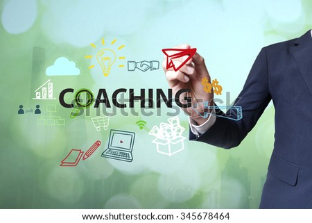 Businessman writing and drawing coaching concept on blurred abstract background , business concept  - stock photo