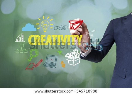 Businessman writing and drawing creativity concept on blurred abstract background , business concept  - stock photo
