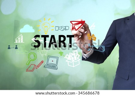 Businessman writing and drawing start concept on blurred abstract background , business concept  - stock photo