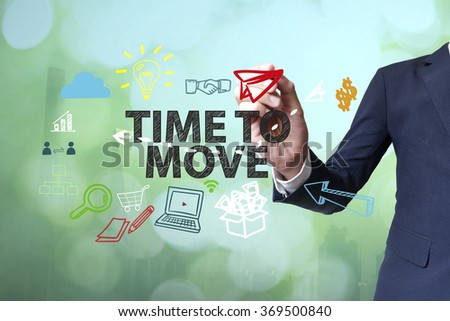 Businessman writing and drawing TIME TO MOVE  concept on blurred abstract background , business concept , business idea - stock photo