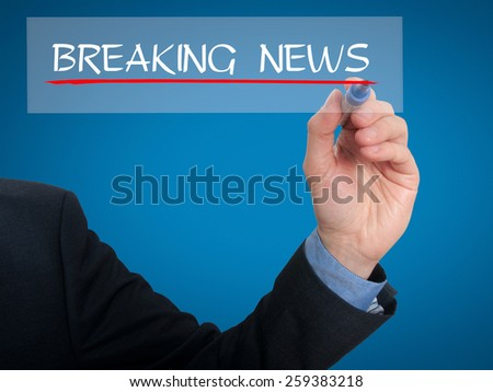 Businessman writing breaking news in the air - Stock Image - stock photo