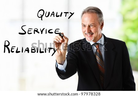 Businessman writing business goals on the screen - stock photo