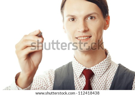 Businessman writing by pen on a whiteboard - stock photo