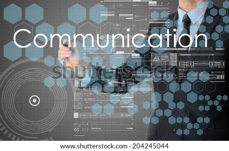 businessman writing Communication and drawing some sketches - stock photo