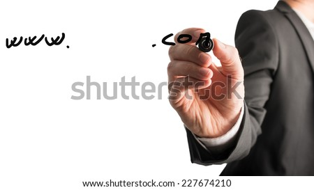 Businessman writing contact details on a virtual screen with a black marker with the handwritten words - www.....com - over white with copyspace. - stock photo