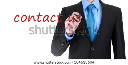 Businessman writing Contact us on transparent board - stock photo