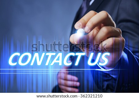 Businessman writing contact us on virtual screen. Internet and networking concept. - stock photo