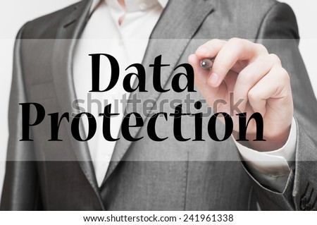 Businessman writing Data Protection Concept - stock photo