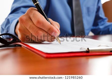 Businessman writing documents