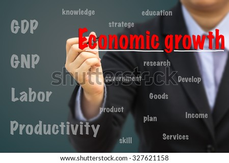 Businessman writing Economic growth relation concept.