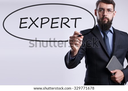 Businessman writing Expert with marker on transparent board. Business, internet, technology concept. - stock photo