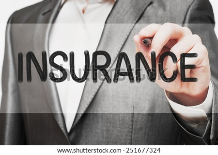 Businessman writing Insurance Concept - stock photo