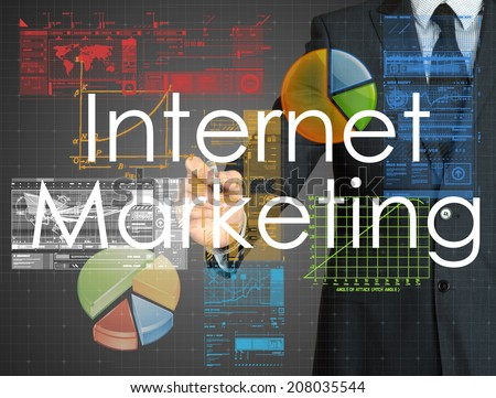 businessman writing Internet Marketing and drawing graphs and diagrams on grey background  - stock photo