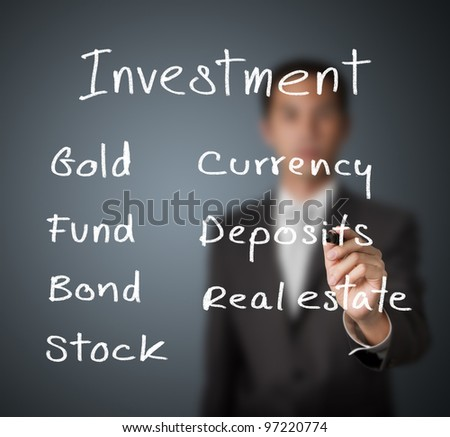 businessman writing investment concept - stock photo