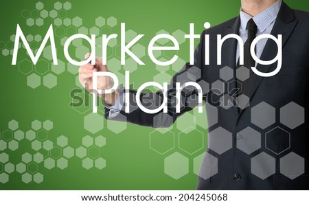 businessman writing Marketing Plan and drawing with some modern pattern in background - stock photo