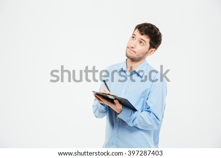 Businessman writing notes in clipboard isolated on a white background