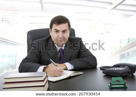 businessman writing on a desk, at the office
