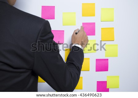 Businessman writing on a notepaper