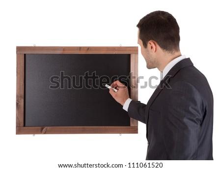 Businessman writing on blackboard. Isolated on white - stock photo