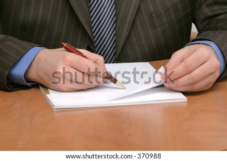 businessman writing on blank paper  - closeup