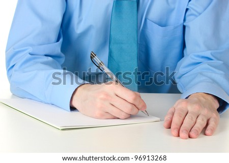 Businessman writing on document - stock photo