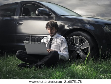 Businessman writing on his pc - stock photo