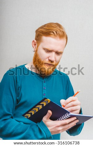 businessman writing on notebook