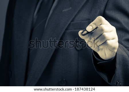 Businessman writing on screen as background for text or sketching