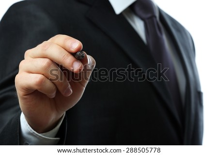 Businessman writing on screen close up