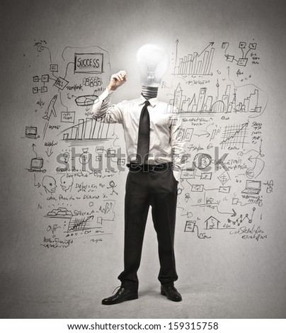 businessman writing on the wall with the head in the shape of a light bulb