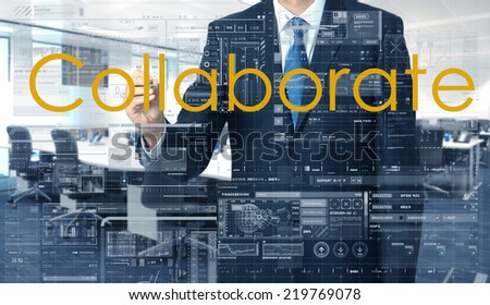 businessman writing on transparent board Collaborate with office in background - stock photo