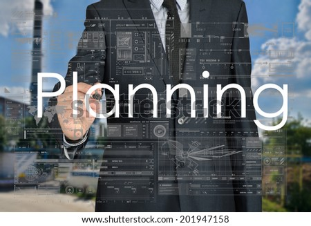 businessman writing planning in the background is a factory landscape - stock photo