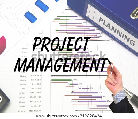 Businessman writing Project Management. Project management icons on the background - stock photo