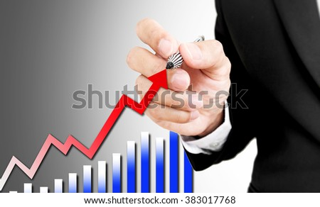 Businessman writing rising arrow and bar graph, business abstract concept