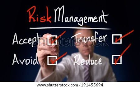 Businessman writing risk management avoid - accept concept - stock photo