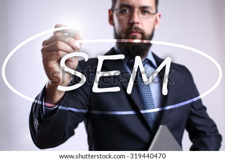 """Businessman writing """"SEM"""" with marker on transparent board. Business, internet, technology concept. - stock photo"""