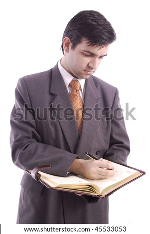 Businessman writing something important in his agenda isolated over white background