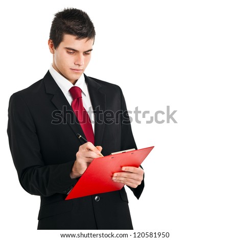 Businessman writing something on a clipboard - stock photo
