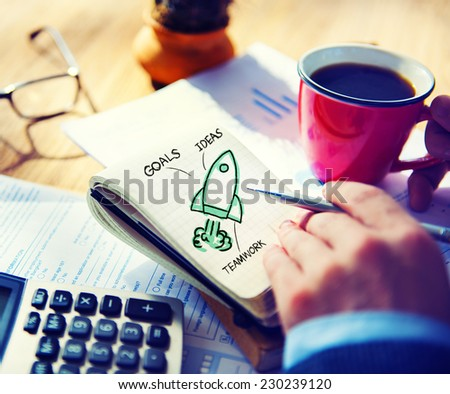 Businessman Writing Start Up Goals Launch Concept - stock photo
