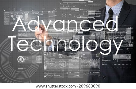 businessman writing technological terminology on virtual screen with modern business or technology background - Advanced Technology - stock photo