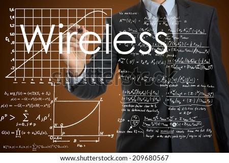 businessman writing technological terminology on virtual screen with modern business or technology background - Wireless