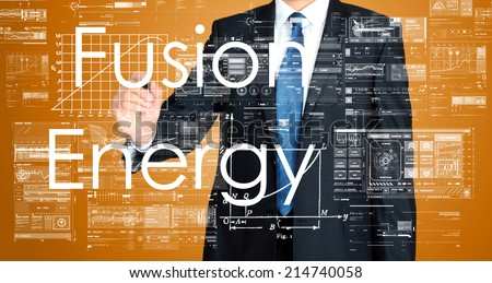 businessman writing technological terminology on virtual screen with modern business or technology background - Fusion Energy - stock photo
