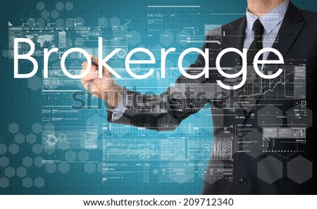 businessman writing technology terminology on virtual screen with business or technology background - brakerage - stock photo