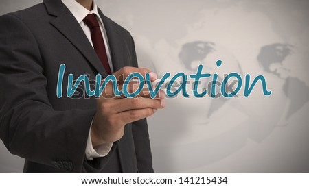 Businessman writing the word innovation with map on the background - stock photo