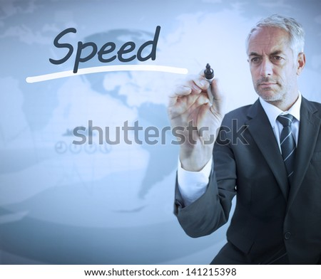 Businessman writing the word speed with a marker - stock photo
