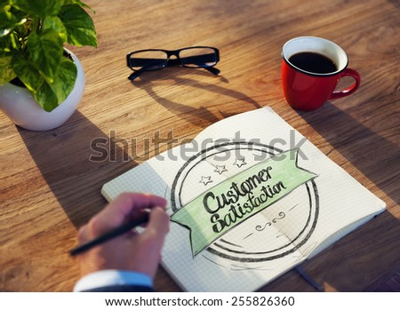 "Businessman Writing the Words ""Costumer Satisfaction"" - stock photo"