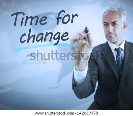 Businessman writing time for change with a marker - stock photo