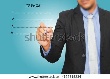 Businessman writing to do list - stock photo