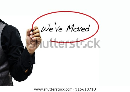 Businessman writing We've Moved - stock photo