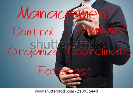Businessman writing with pen about management skill and responsibility on virtual screen